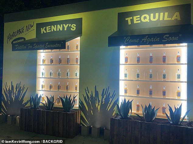 Outside the restaurant, popular among A-list celebrities, was a pop-up display, which featured a wall of her new alcoholic beverages and read: 'Kenny's Tequila'