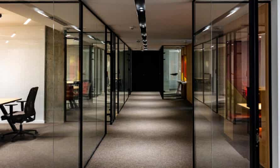 Empty corridor in modern office building at nightEmpty company office in time of coronavirus quarantine.