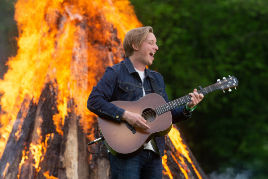 George Ezra performs by a fire as part of the Glastonbury Festival Global Livestream event
