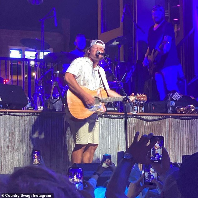 Music mode: The 28-year-old country musician took the stage at Kid Rock's Big Honky Tonk & Steakhouse bar in Nashville to a completely packed house and performed a few of his hits on Wednesday night