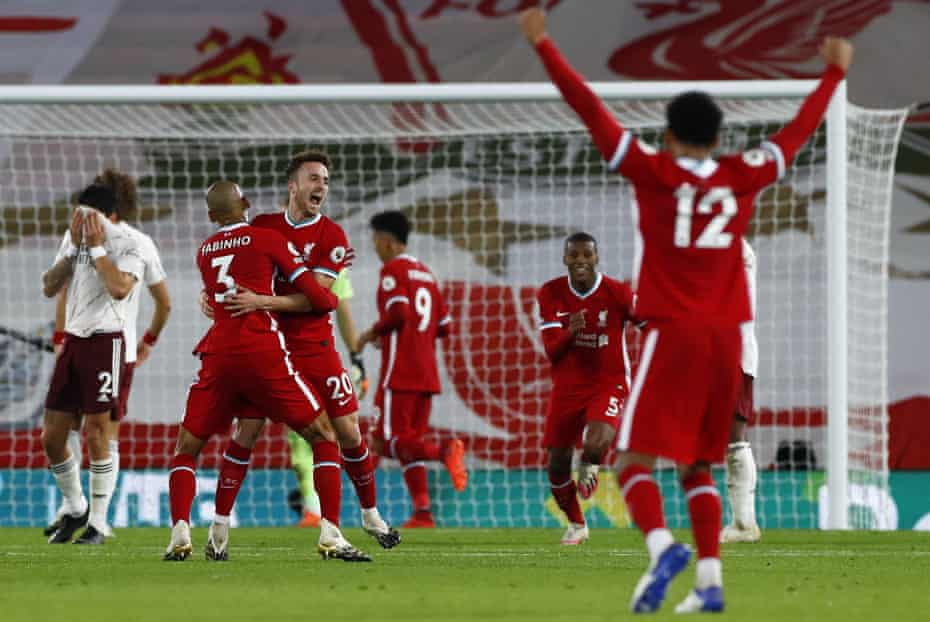 Liverpool's Diogo Jota is congratulated by teammates after scoring his team's third goal against Arsenal at Anfield.