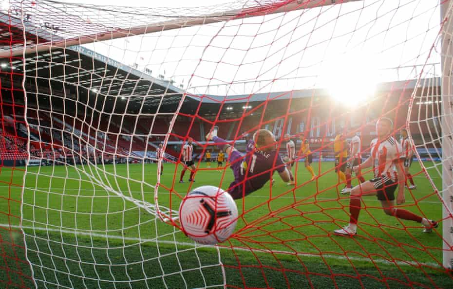 Romain Saiss of Wolverhampton Wanderers scores to make it 2-0 against Sheffield United at Bramall Lane.