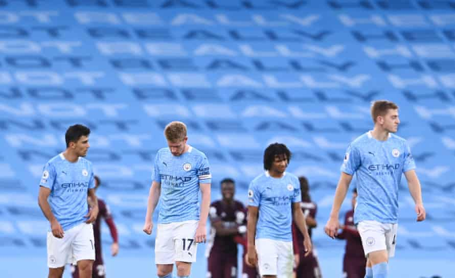 Manchester City's players look dejected after Leicester City's Youri Tielemans scores their fifth goal.