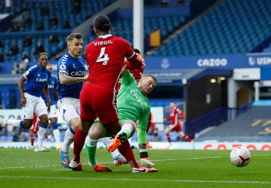 Evertomn goalkeeper Jordan Pickford lunges into Virgil van Dijk of Liverpool, ending his opponent's season.