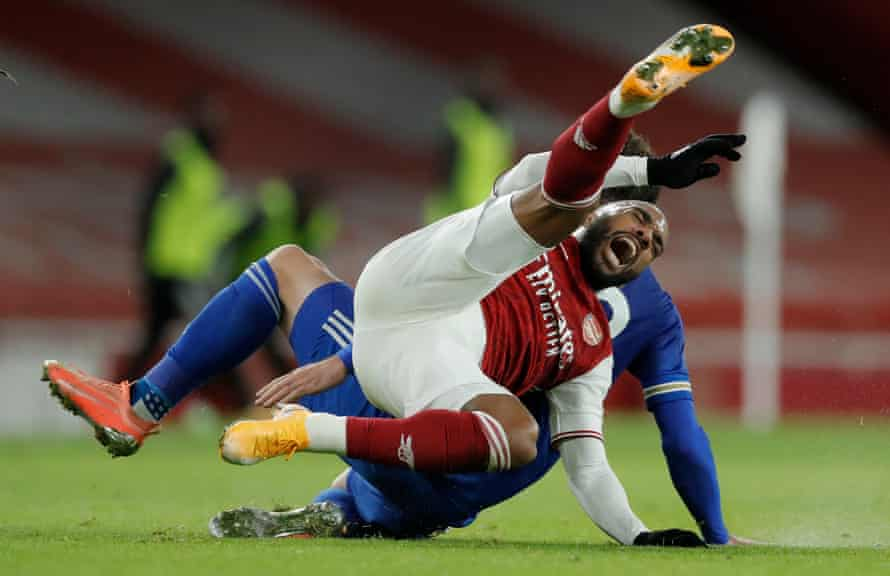 Arsenal's Alexandre Lacazette is fouled by Leicester City's Christian Fuchs at the Emirates Stadium.