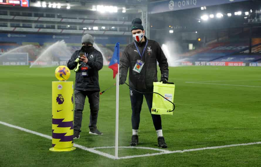 The corner flag is disinfected before a match at Selhurst Park.