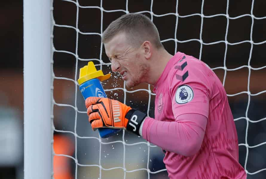 Everton keeper Jordan Pickford sprays water in his eyes just before kick off against Fulham at Craven Cottage.