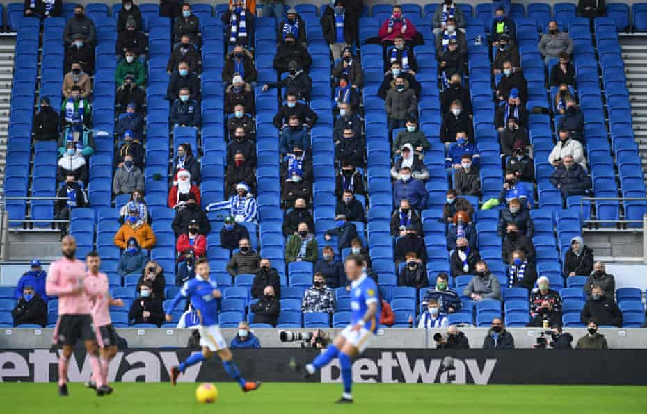 Supporters wearing face-masks while social-distancing at the Amex in Brighton.