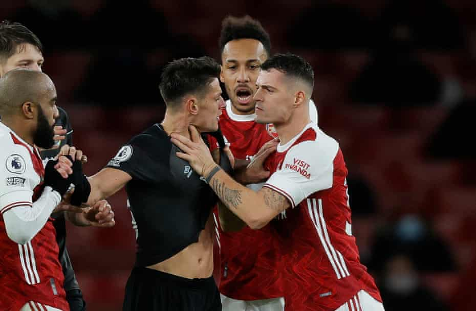 Granit Xhaka of Arsenal grabs Ashley Westwood of Burnley around the throat and gets a red card.