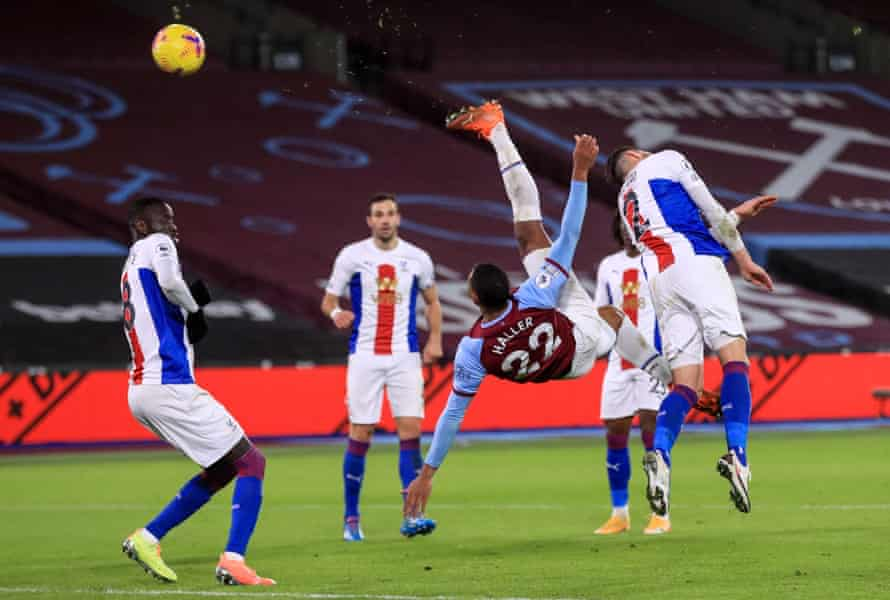 West Ham United's French striker Sebastien Haller scores an acrobatic goal against Crystal Palace at The London Stadium.