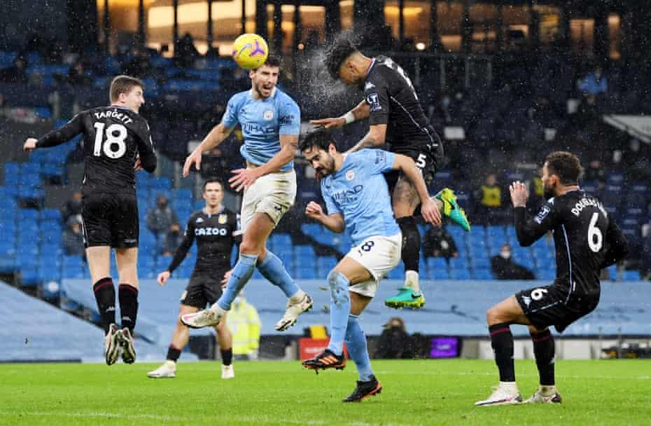 Aston Villa's Tyrone Mings in action with Manchester City's Ruben Dias and Ilkay Gundogan.