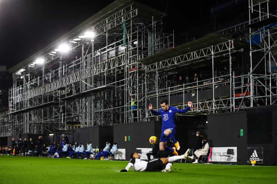 A view of of the partially constructed Riverside Stand at Craven Cottage as Kenny Tete of Fulham tackles Ben Chilwell of Chelsea.