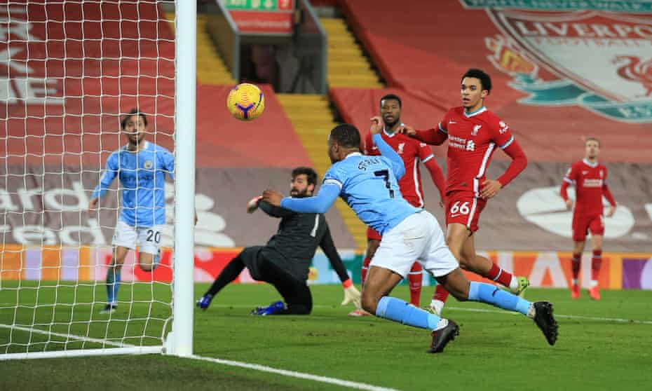 Raheem Sterling scores Manchester City's third goal against Liverpool at Anfield.