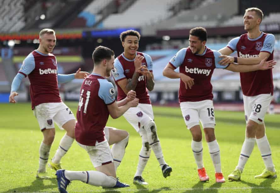 West Ham United's Jesse Lingard (centre) celebrates with a mock band after scoring against Tottenham.