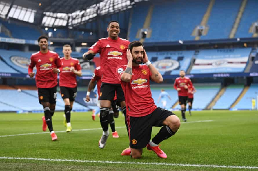 Bruno Fernandes of Manchester United celebrates after scoring a penalty against Manchester City at Etihad Stadium.
