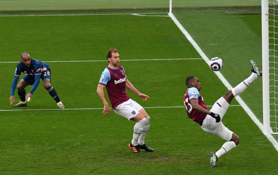 West Ham United's French defender Issa Diop makes a goal-line clearance against Arsenal at The London Stadium.