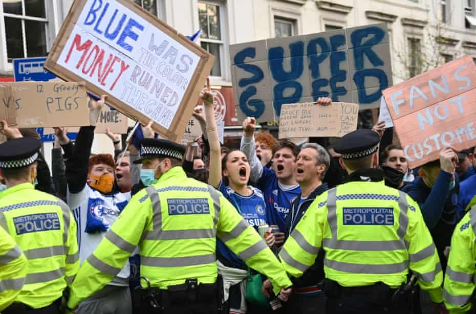 Chelsea fans stage a demonstration against the proposed European Super league before their match with Brighton.