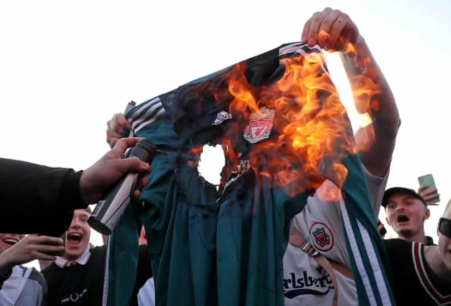 Football fans burn a replica Liverpool shirt outside Elland Road before their match with Leeds in protest at the ESL.