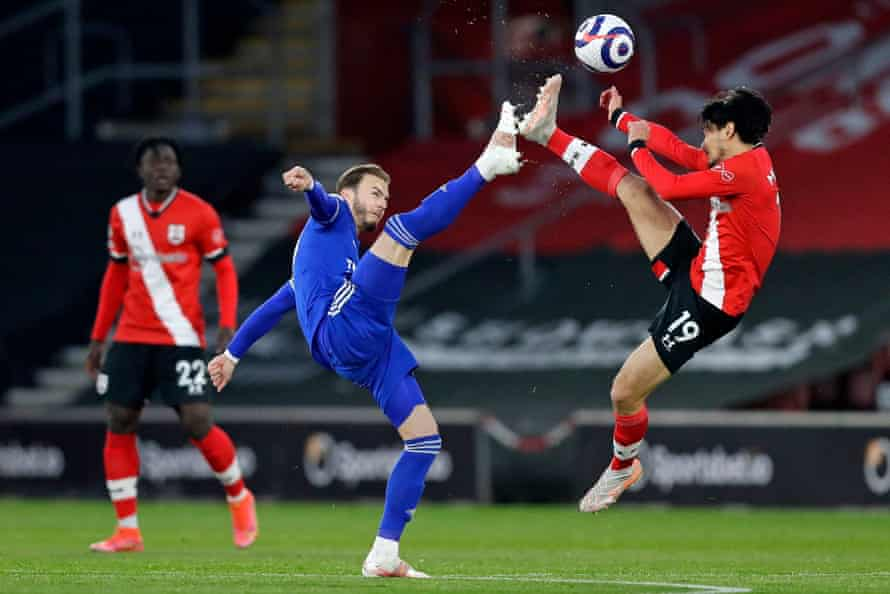 Leicester City's English midfielder James Maddison vies with Southampton's Japanese midfielder Takumi Minamino at St Mary's Stadium.