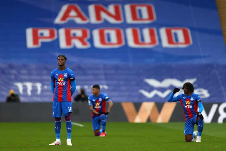 In objection to the ongoing threat of racism in society, Wilfried Zaha of Crystal Palace opts to stand while his team-mates Patrick van Aanholt and Eberechi Eze take a knee before kick-off against Chelsea.