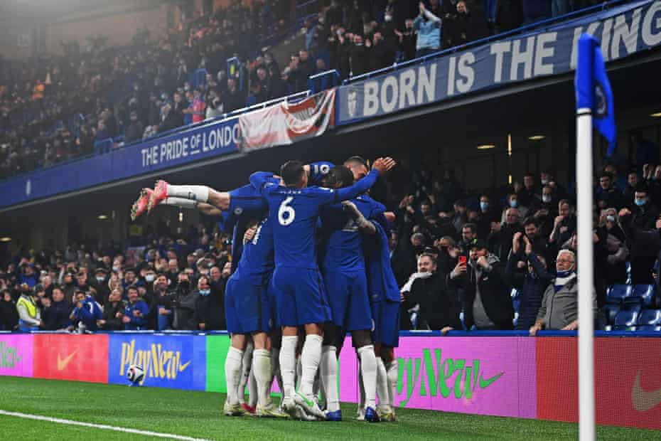 Chelsea's Italian midfielder Jorginho is mobbed by team-mates after scoring their second goal in a critical match with Leicester City at Stamford Bridge.