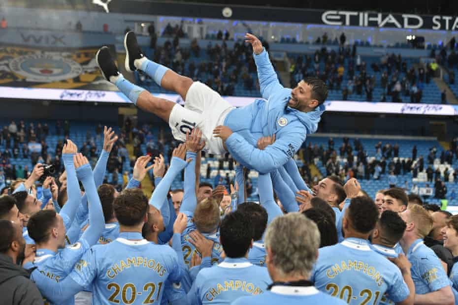 Manchester City legend Sergio Aguero is thrown up in the air by team-mates after his final league match for the newly-crowned champions.