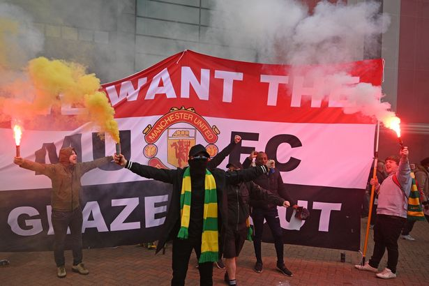 Supporters protest against Manchester United's owners after the Super League proposals became public