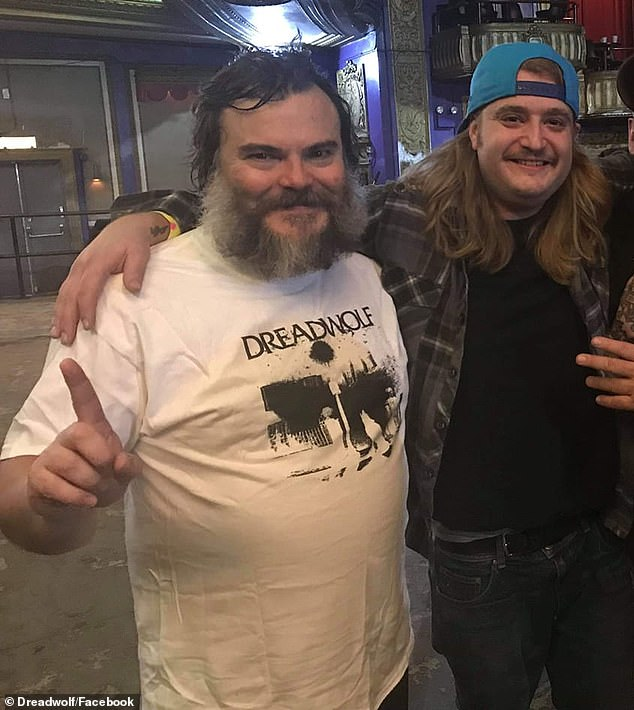 Reunited: Clark (right) posed with Jack Black (left) backstage ata Tenacious D concert in Chicago in 2018, staging a mini-reunion