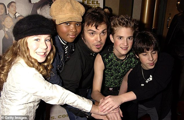 World traveler: Clark is seen next to Black at the London premiere of School of Rock in 2003