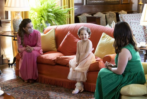 The Duchess of Cambridge meeting Mila Sneddon, aged five, at the Palace of Holyroodhouse in Edinburgh
