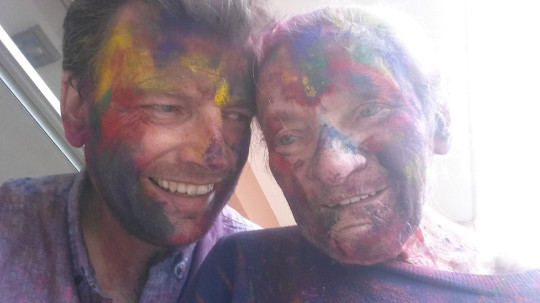 Sean O'Sallaigh and his mother Mary O'Niel in Nepal celebrating Holi. 2018. See SWNS story SWTPalzheimer's. A son has described how his mum's Alzheimer's disease improved as he took her travelling across the world in her final years. Sean O'Sallaigh, 44, was a full time carer for his mum, Mary O'Niel, and decided to take her to Nepal to escape the harsh Irish winter. Sean was amazed when Mary, who had Alzheimer's disease, started walking and talking again during their trip. He decided to keep travelling with her until she died in South Africa 18 months later.