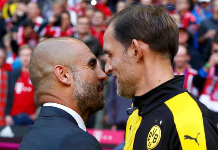 Thomas Tuchel talks to Pep Guardiola before his Borussia Dortmund team take on Bayern Munich in October 2015.