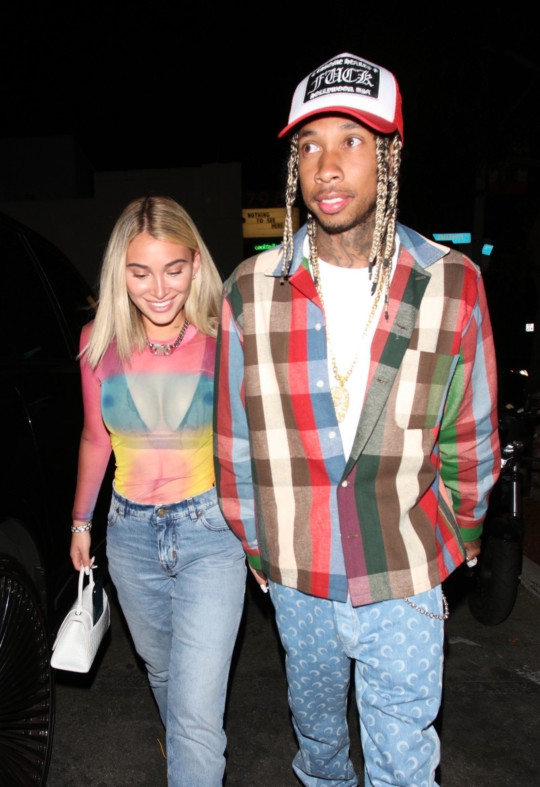 West Hollywood, CA - Tyga seen leaving Delilah with his girlfriend . Pictured: Tyga BACKGRID USA 22 MAY 2021 BYLINE MUST READ: HEDO / BACKGRID USA: +1 310 798 9111 / usasales@backgrid.com UK: +44 208 344 2007 / uksales@backgrid.com *UK Clients - Pictures Containing Children Please Pixelate Face Prior To Publication*