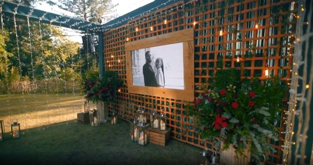 Andre had set up a walkway in the garden with a black and white picture of the couple at the end