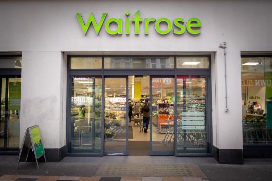 A Waitrose & Partners store front.