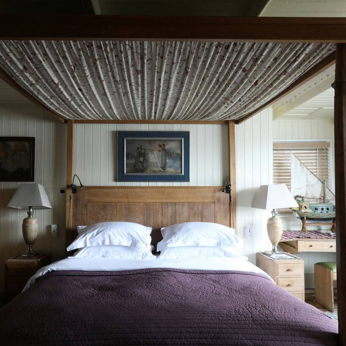 ...to its bedrooms, one of which features a four-poster bed that belonged to the early 20th-century socialite/heiress Daisy Fellowes