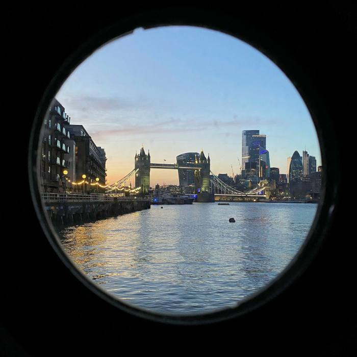 The view through one of the portholes at sunset