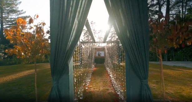 The romantic video starts with a shot of the garden walkway, strung with fairy lights