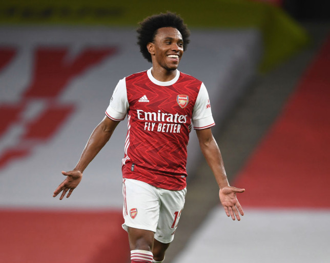 Willian celebrates scoring the 3rd Arsenal goal during the Premier League match between Arsenal and West Bromwich Albion at Emirates Stadium on May 09, 2021 in London, England. Sporting stadiums around the UK remain under strict restrictions due to the Coronavirus Pandemic as Government social distancing laws prohibit fans inside venues resulting in games being played behind closed doors.