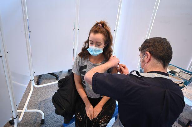 Person getting vaccine