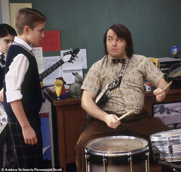 School of Rock child star Kevin Clark dead at 32: Actor fatally hit by motorist while riding his bicycle in Chicago (pictured left in the movie with Jack Black)