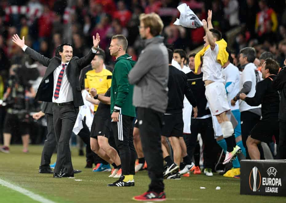 Sevilla head coach Unai Emery (left) celebrates at the final whistle after beating Liverpool 3-1 to win the 2016 Europa League final.