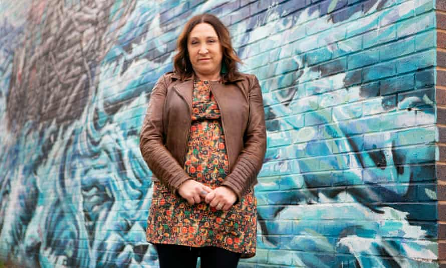 Council leader Janette Williamson  in front of a mural