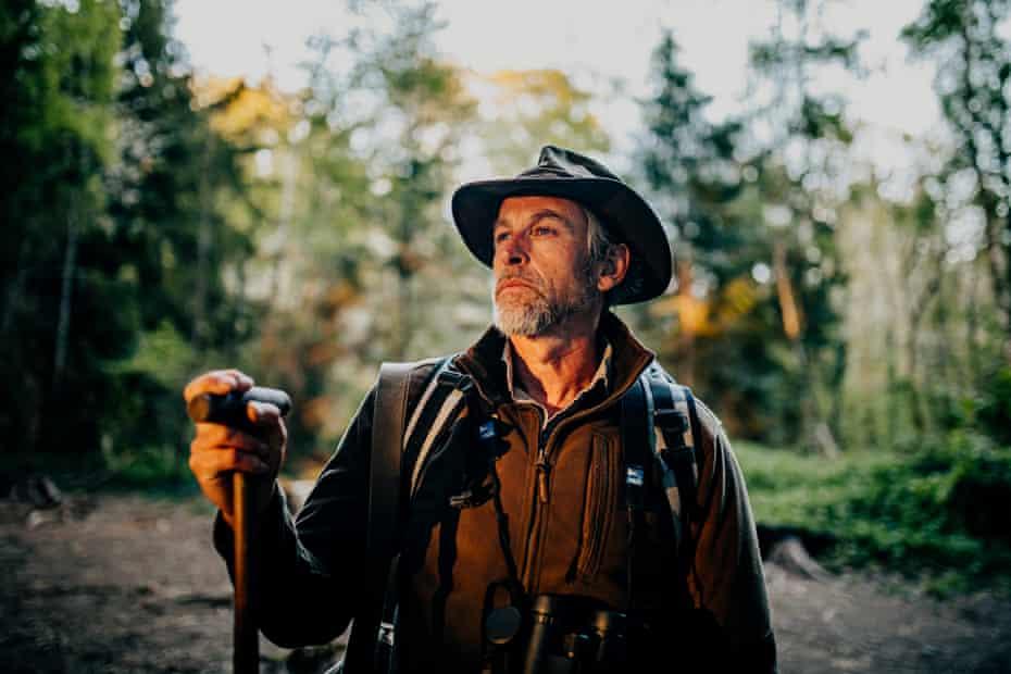 The outdoor educator Chris Salisbury in woodland near the River Dart in Devon.