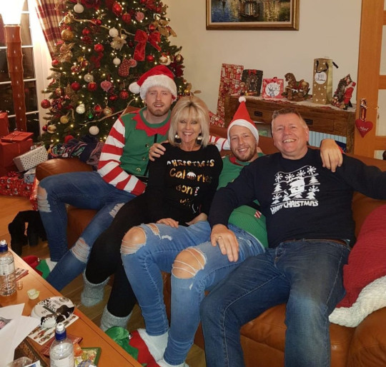 Adam Thompson with Mum Tracey, Dad Mark and brother Olly