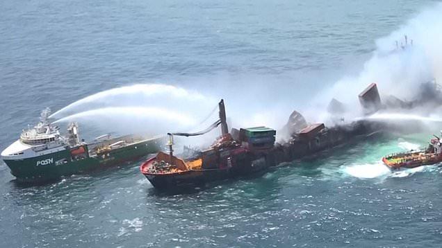 Burning ship anchored off Sri Lanka leaks chemicals onto beaches