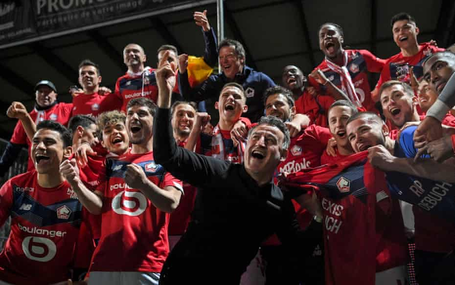 Christophe Galtier leads the celebrations as Lille win the league.