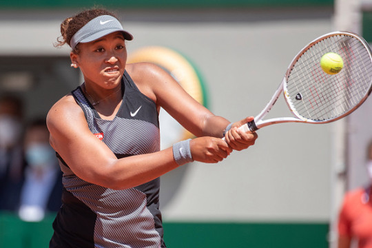 Naomi Osaka of Japan in action against Patricia Maria Tig of Romania in the first round of the Women's Singles competition on Court Philippe-Chatrier at the 2021 French Open Tennis Tournament at Roland Garros on May 30th 2021 in Paris, France.