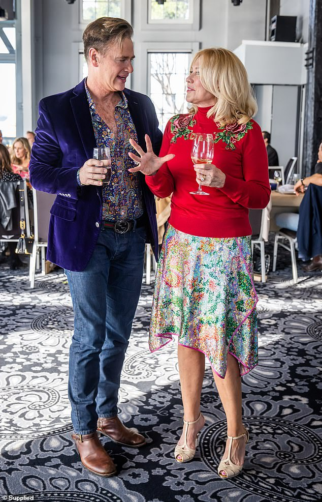Catching up: Kerri-Anne was also seen enjoying a lively conversation with entertainment reporter Richard Reid, with whom she is good friends