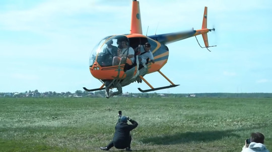 The helicopter takes off with 'Zheka' Namitov attached to the underside.